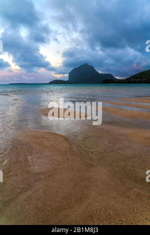 Dusk clouds on Le Morne mountain and tropical beach, Le Morne Brabant, Black River district, Indian Ocean, Mauritius - Stock Photo