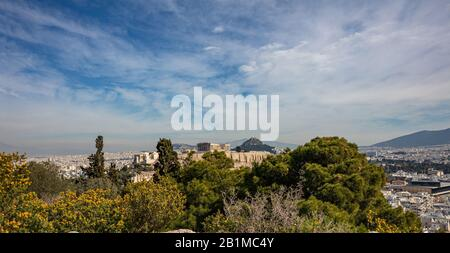 Athens Acropolis, Greece. Scenic view of ancient Greece remains seen from Philopappos Hill. Urban cityscape of Athens, sunny day in winter. - Stock Photo