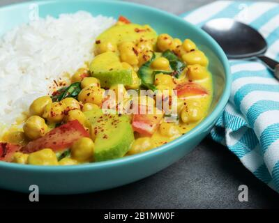 rice, chickpeas, zucchini, with coconut milk and curry  sauce. vegetarian dish - Stock Photo