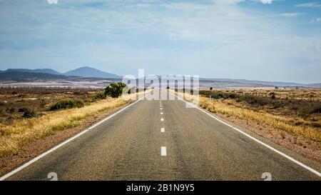 road leading to the horizon, Australia - Stock Photo