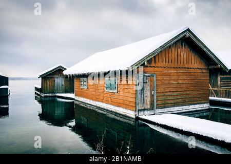 snow covered boat house in Tutzing at Lake Starnberg, Germany, Bavaria - Stock Photo
