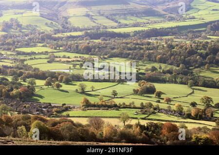Sunshine over green fields and autumn trees in Hope Valley, Peak District National Park, Derbyshire, England, UK Stock Photo