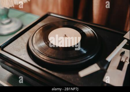 old musical instrument for playing vinyl records, russian retro musical instrument with needle for playing - Stock Photo