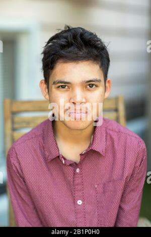 Young mixed race teenage boy looking at the camera