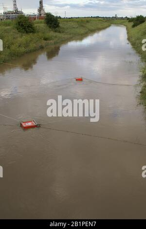 flooded rural road, high volume pumps in action - Stock Photo