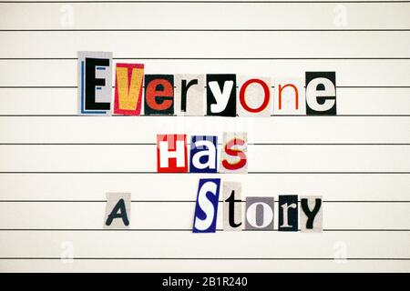 Phrase Everyone Has a Story made from letters cutting from magazines on lined paper.