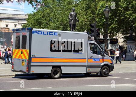 LONDON, UK - JULY 6, 2016: Mercedes Sprinter police vehicle in London, UK. Metropolitan Police Service has 31,000 police officers in Greater London ar - Stock Photo