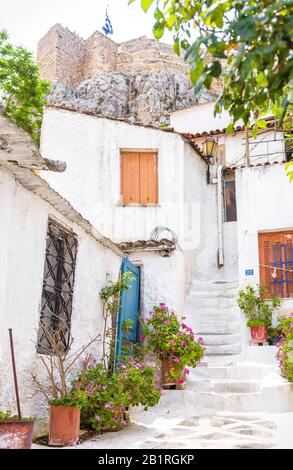 Scenic narrow street with old houses in Anafiotika, Plaka district, Athens, Greece. Plaka is one of the main tourist attractions of Athens. Beautiful - Stock Photo