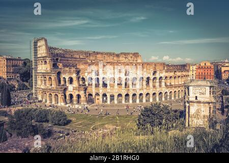 Panoramic view the Colosseum (Coliseum) in Rome, Italy. The Colosseum is the main tourist attractions of Rome. It was built in the 1st century. - Stock Photo