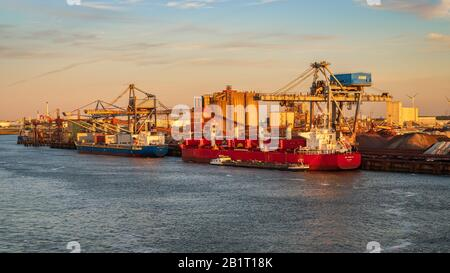 Rotterdam, South Holland, Netherlands - May 13, 2019: View towards the ships on the Calandkanaal at the Europoort - Stock Photo