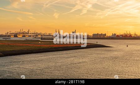 Rotterdam, South Holland, Netherlands - May 13, 2019: Evening light over the Europoort - Stock Photo