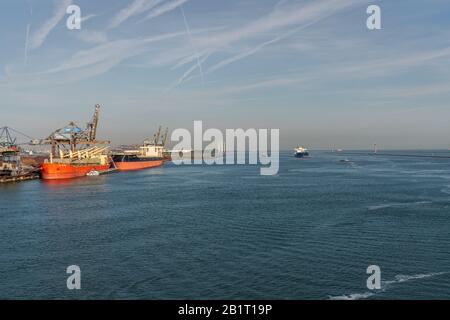 Rotterdam, South Holland, Netherlands - May 23, 2019: Ships and industry in the Beneluxhaven of Europoort - Stock Photo