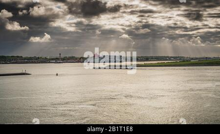 Rotterdam, South Holland, Netherlands - May 10, 2019: View from the Calandkanaal towards the ferry terminal in Hook of Holland - Stock Photo