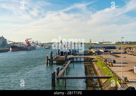 Rotterdam, South Holland, Netherlands - May 13, 2019: Ships and industry in the Beneluxhaven of Europoort - Stock Photo