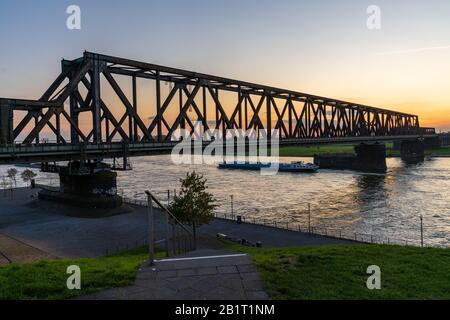 Duisburg, North Rhine-Westfalia, Germany - November 09, 2019: View from the Rheinpark towards the Railway bridge in Hochfeld Stock Photo