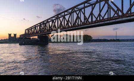 Duisburg, North Rhine-Westfalia, Germany - November 09, 2019: View from the Rheinpark towards the Railway bridge in Hochfeld with the old bridge tower Stock Photo