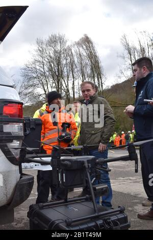 Environment Secretary George Eustice speaking with Environment Agency staff as he is shown a drone being used to monitor compromised flood defences in Ironbridge in Shropshire, where flood barriers buckled on Wednesday due to the weight of water in the River Severn. - Stock Photo