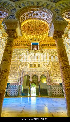 SEVILLE, SPAIN - OCTOBER 1, 2019: The marble columns of the arched entrance to the Salon de los Embajadores (Ambassadors Hall) in King Pedro Palace in - Stock Photo