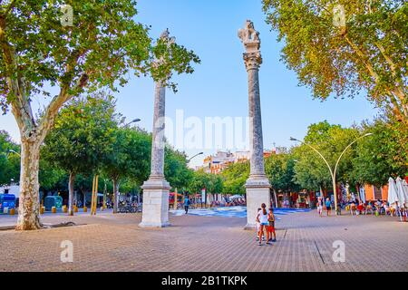 SEVILLE, SPAIN - OCTOBER 1, 2019: High marble columns with sculptures of the lions on La Alameda square are the visitcard of Seville, on October 1 in - Stock Photo