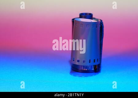 Film of an analogue camera with colorful background photographed in the studio - Stock Photo