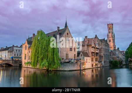 Famous viewpoint in Bruges. View on Bruges old town and Belfry tower with pink sky during twilight, Bruges, Belgium