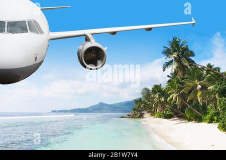 Airplane Is Flying Over Island And Sea In Summer At Seychelles - Stock Photo