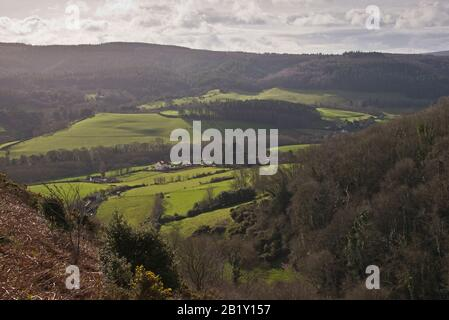 view looking southwards across the open countryside towards Woodcombe and Bratton from high up Wood Combe, near Minehead in the Exmoor National Park - Stock Photo