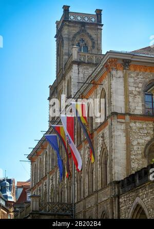 Weimar, Germany, historical building of the town hall with flags of europe, thuringia and germany - Stock Photo