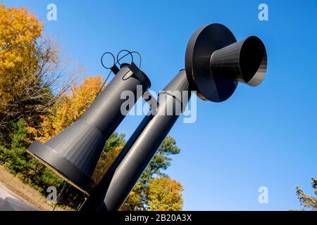 World's Largest Telephone. An old-fashioned candlestick phone, 14 feet tall. Bryant Pond the last US town to give up hand cranked telephones - Stock Photo