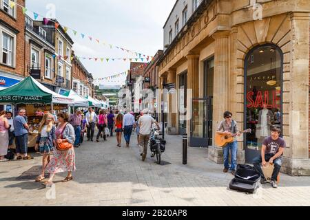 WINCHESTER, UK - July 27, 2012. Pedestrianised high street in Winchester, Hampshire, UK - Stock Photo