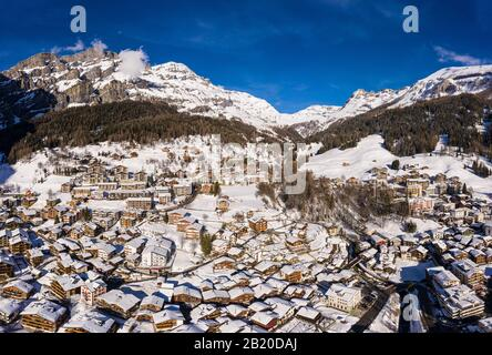 Stunning aerial panorama of the Leukerbad mountain village at the bottom of the Gemmi pass in Canton Valais in the alps in Switzerland on a sunny wint