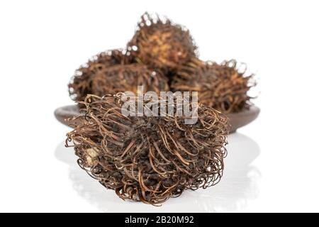 Lot of whole old brown rambutan isolated on white background - Stock Photo