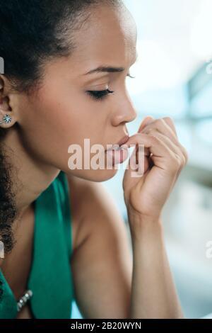 Young Black Woman Feeling Anxious And Biting Nails