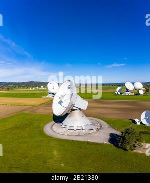 Large parabolic antennas of the Raisting earth station, Bavaria, Germany - Stock Photo