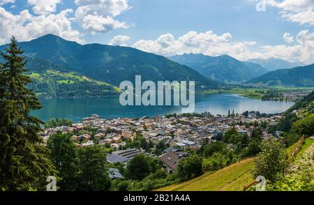 Panorama of the city of Zell am See with Zeller Lake in summer. Nature panoramic view of mountain, meadows and Tirol Alps in Salzburger Land, Austria. - Stock Photo