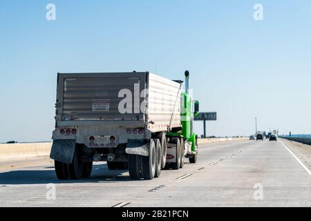 Slidell, USA - April 24, 2018: Highway i10 interstate road bridge with traffic commute from New Orleans with truck and sign - Stock Photo