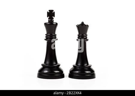 King and queen, two simple chess figures isolated on white, cut out. Royal couple, royalty abstract concept, pair of game pieces, chess symbol, power - Stock Photo