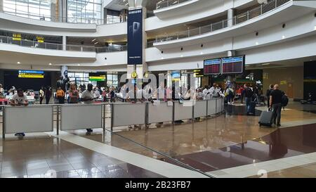 Johannesburg, South Africa - 18 Feb 2020: The ariport in Johannesburg in South Africa where people are busy moving on, arrival hall.