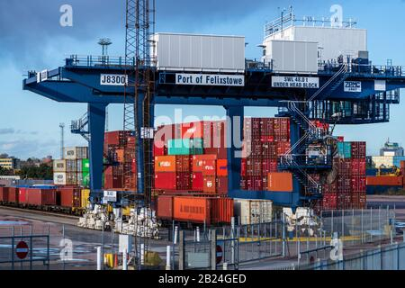 Railway Container Shipping UK. Intermodal containers being loaded onto freight trains for onward transportation from Felixstowe Container Port. - Stock Photo