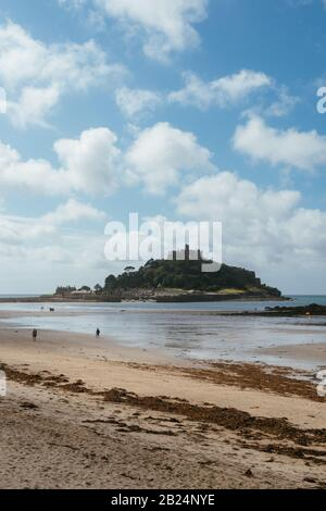 St Michael's Mount and the Cornish coastline as seen from Penzance. - Stock Photo