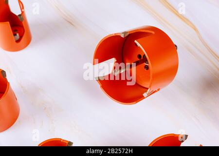 Drill bits hole saw for drill rig drill for wood on table - Stock Photo
