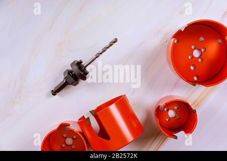 Hole saw or hole cutter tools for wood is a drill of bits hole saw for making large holes in wood - Stock Photo