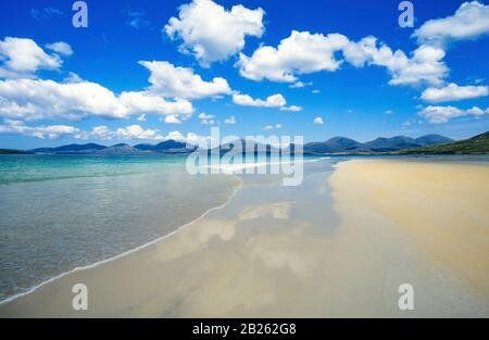 Expanse of smooth sand at Luskentyre (Losgaintir) Beach on a beautiful Summer day in June with blue sky, Isle of Harris, Scotland, UK