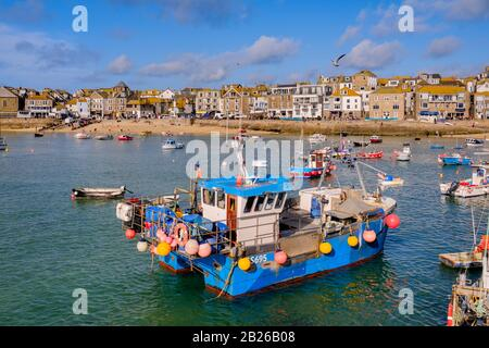 Views across St Ives Harbour to St Ives village and Smeatons Pier with boats in the Harbour, Cornwall, South West, UK