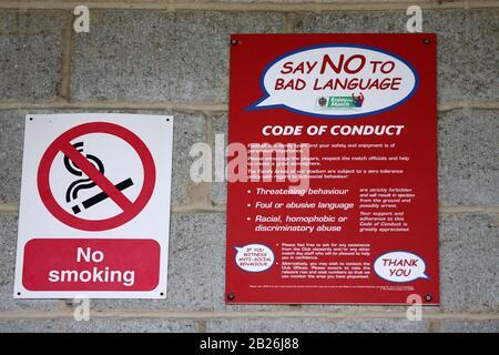Code Of Conduct signage during Dagenham & Redbridge vs FC Halifax Town, Vanarama National League Football at the Chigwell Construction Stadium on 8th - Stock Photo