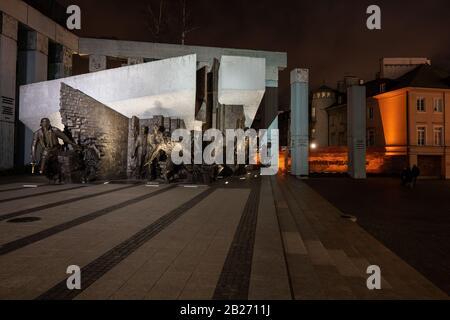 Warsaw Uprising Monument (Polish: Pomnik Powstania Warszawskiego) at night in city of Warsaw in Poland - Stock Photo