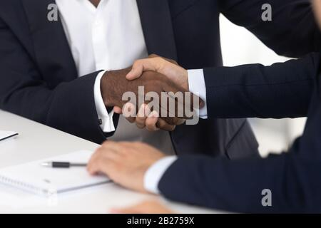 Close up of male handshake after effective negotiation - Stock Photo