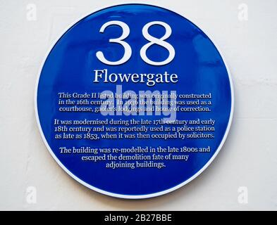 Blue Plaque No. 38 Flowergate recounting the history of the buildings usage since the 16th Century - Stock Photo