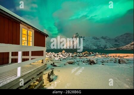 View of Rorbuer during northern lights, Hamnoy, Moskenes, Moskenesoya, Nordland, Lofoten, Norway, Northern Europe - Stock Photo