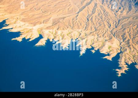 Aerial photography over Nevada with landforms and Lake Mead - Stock Photo